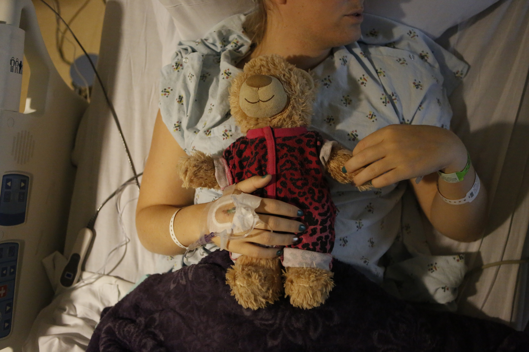 Taylor holds her teddy bear as she recovers from gender reassignment surgery in February 2018.