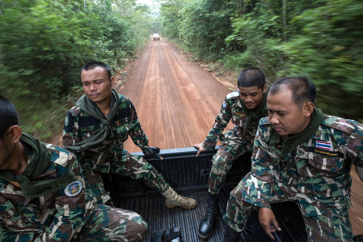 Thai forest rangers leave their ranger station to be dropped off at the edge of the national park for a 3-day patrol. This part of Thailand sees a lot of movement of illegal loggers entering Thailand from Cambodia and moving across to find the remaining rose wood trees. Ta Praya National Park, Sa Kaew Province - September 2018