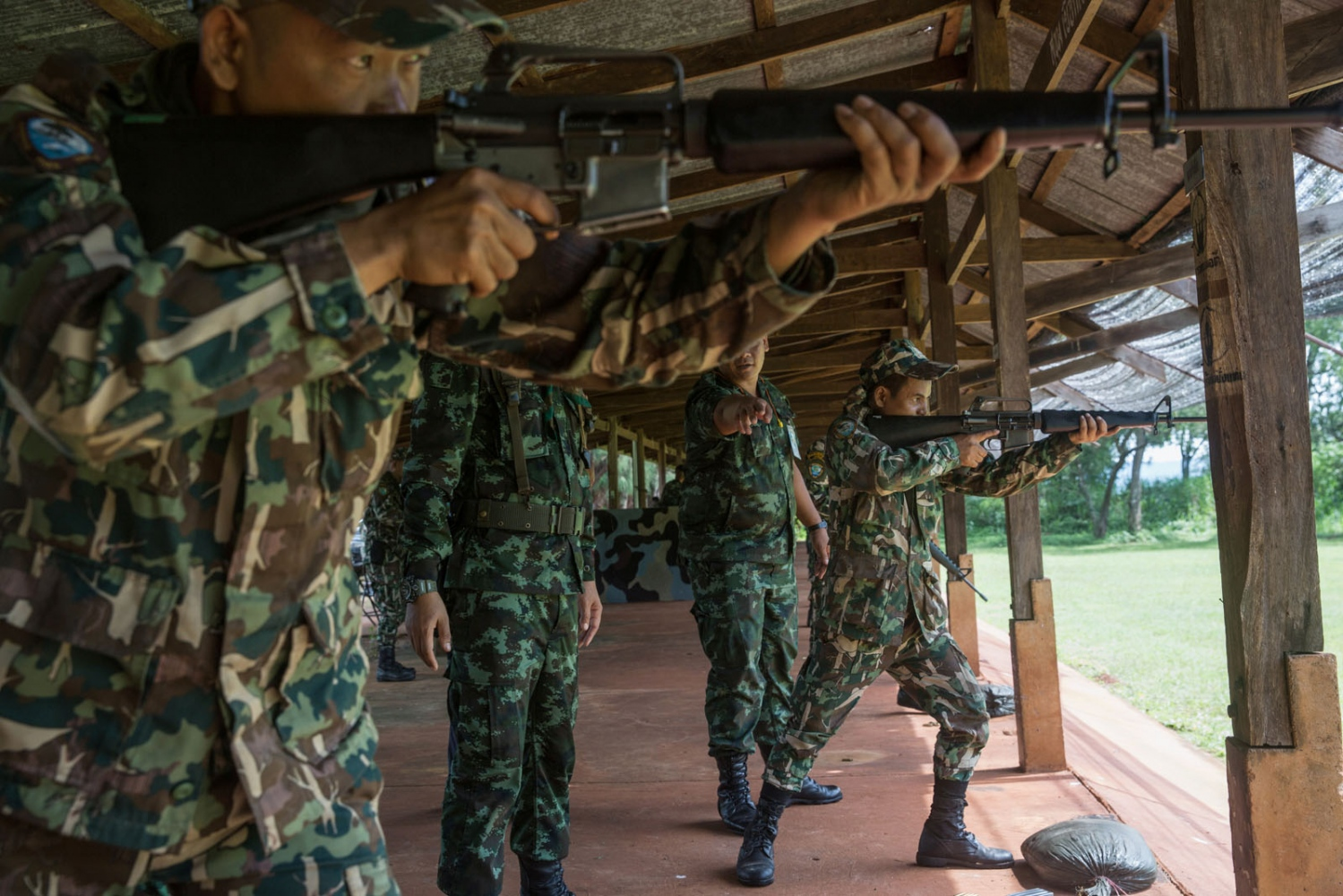 Forest rangers brush up their shooting skills at a nearby army base. Ta Praya National Park, Sa Kaew Province - September 2018