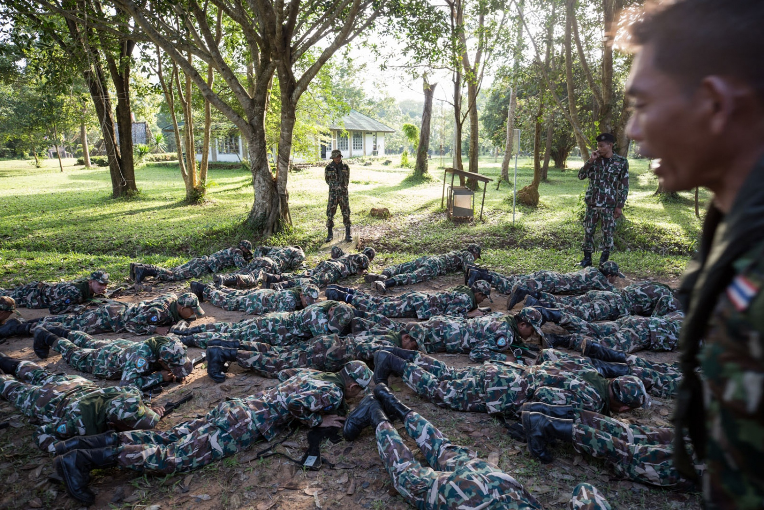 New forest ranger recruits are ordered to do pushups before they are allowed to eat lunch during a week long training course at a remote ranger station in eastern Thailand. Ta Praya National Park, Sa Kaew Province - September 2018