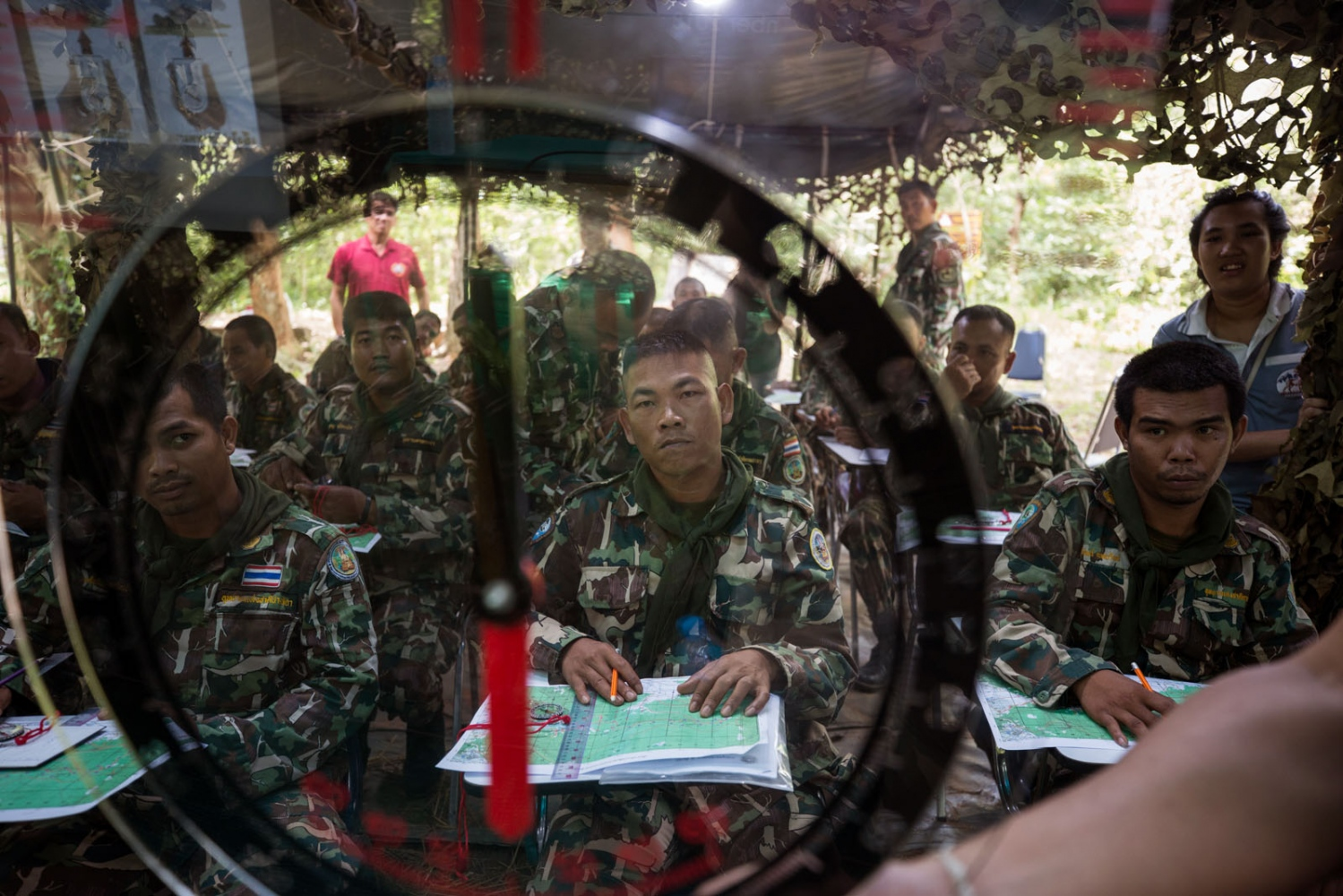 New forest ranger recruits take a lesson in map reading during a week-long training course in a remote ranger station. Ta Praya National Park, Sa Kaew Province - September 2018