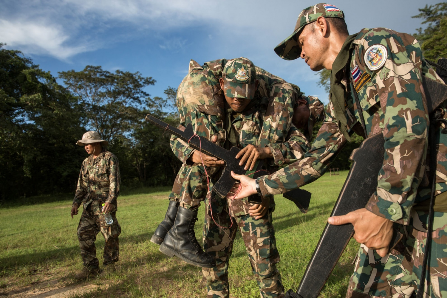 New forest ranger recruits and those on refresher courses take part in a week long training at a remote ranger station in eastern Thailand. Using wooden guns they practice a range of survival scenarios. Ta Praya National Park, Sa Kaew Province - September 2018