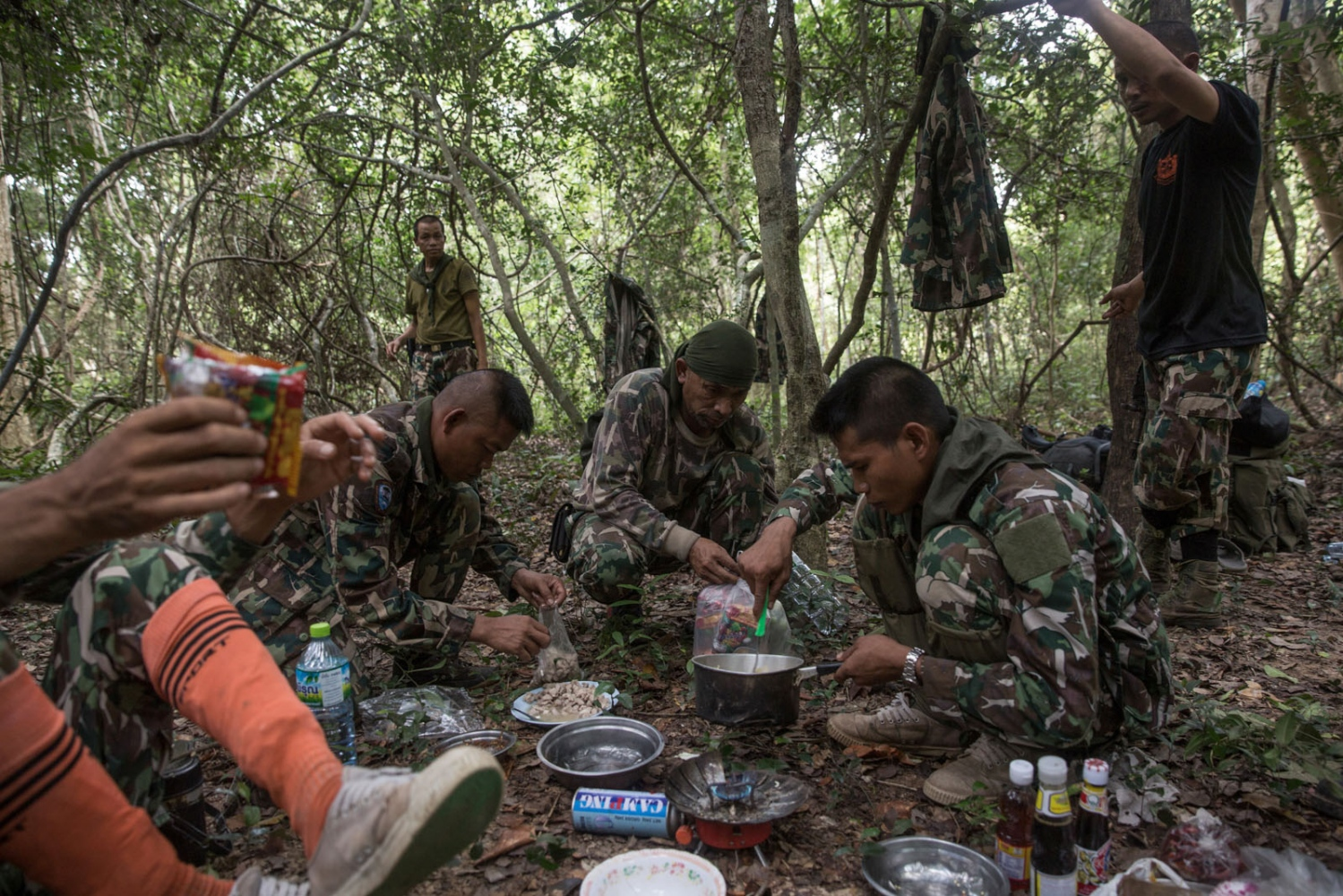 Thai forest rangers break for lunch on a 3 day patrol. Ta Praya National Park, Sa Kaew Province - September 2018