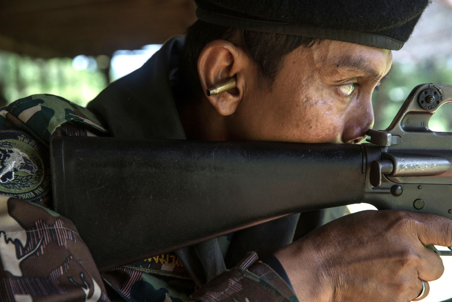 A veteran ranger called Khom undertakes shooting practice at a nearby army base using the spent shell as ear-plugs. Ta Praya National Park, Sa Kaew Province - September 2018