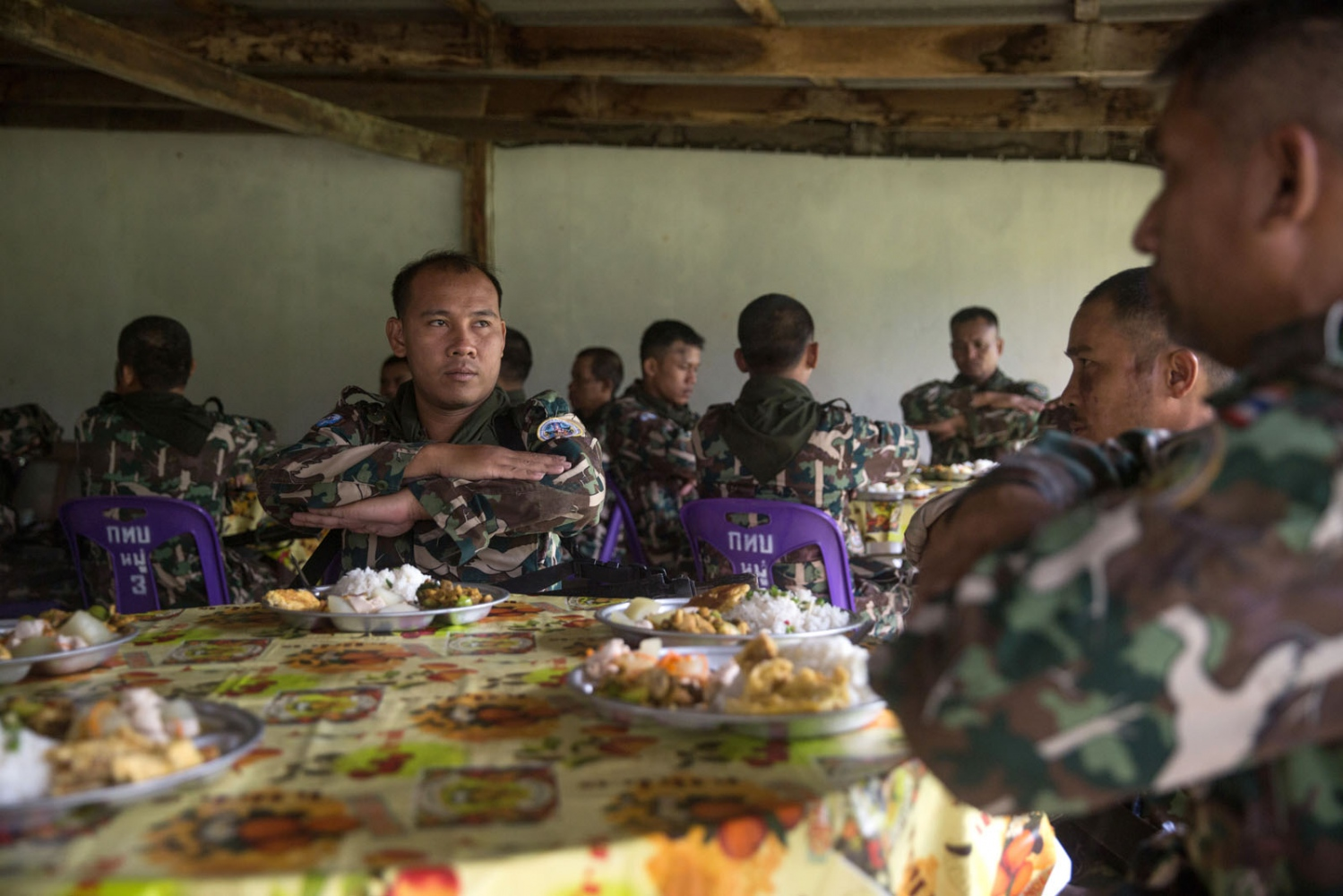 Thai forest rangers must wait for instructions given by their superiors before they can eat during a week-long training course. Ta Praya National Park, Sa Kaew Province - September 2018