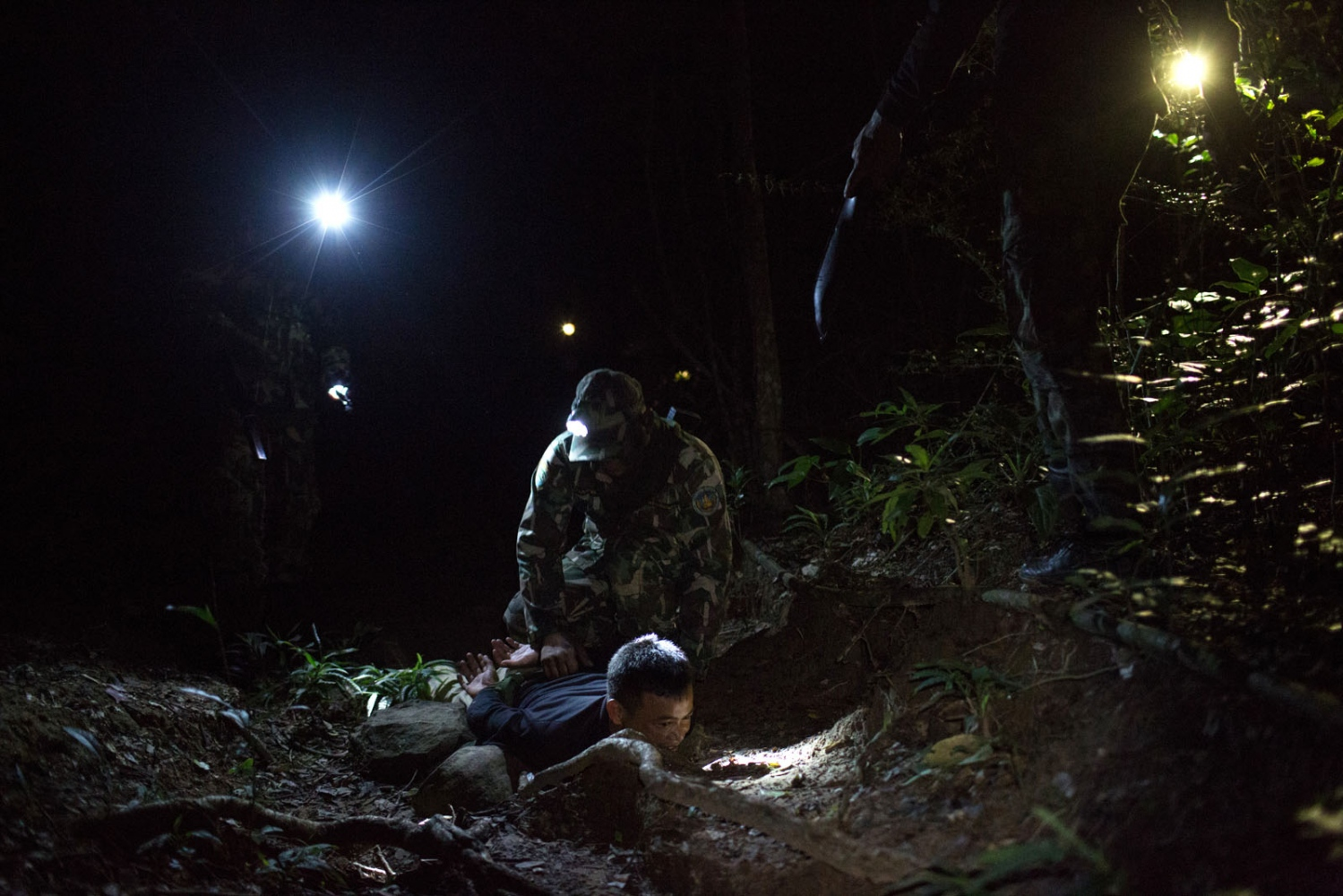 New recruits and those on a refresher course take part in training exercises at night during a 4 day forest ranger training course in Ta Praya National Park. This scenario trains them in ambushing loggers at night. Ta Praya National Park, Sa Kaew Province - September 2018