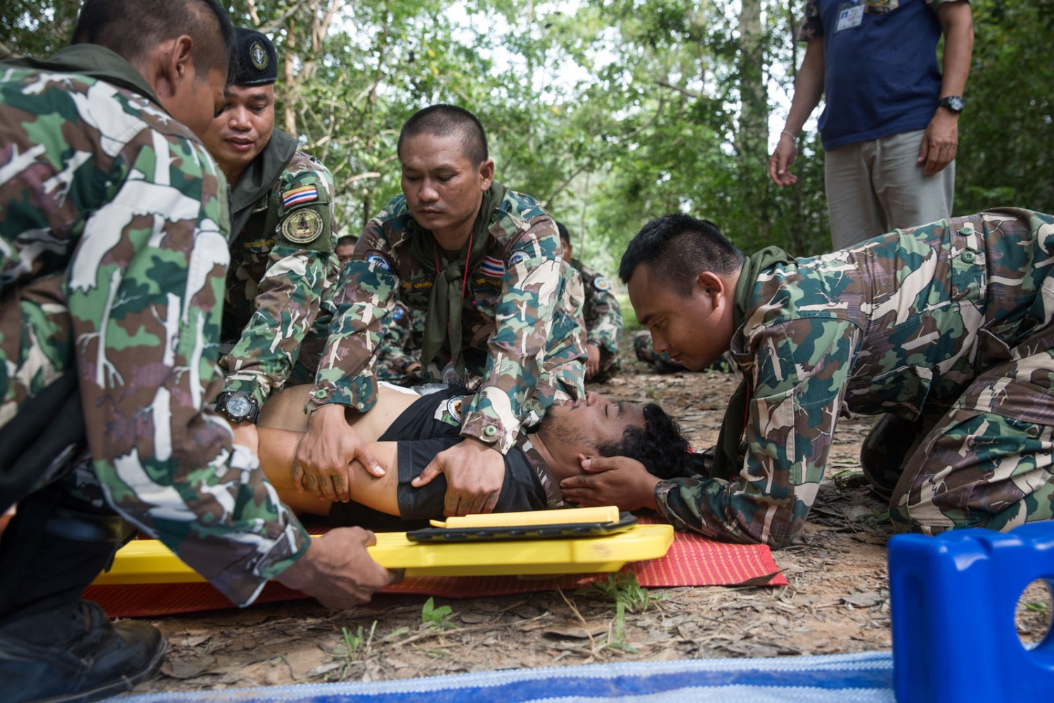 New Thai forest ranger recruits and those on a refresher course practise their first aid skills. Ta Praya National Park, Sa Kaew Province - September 2018