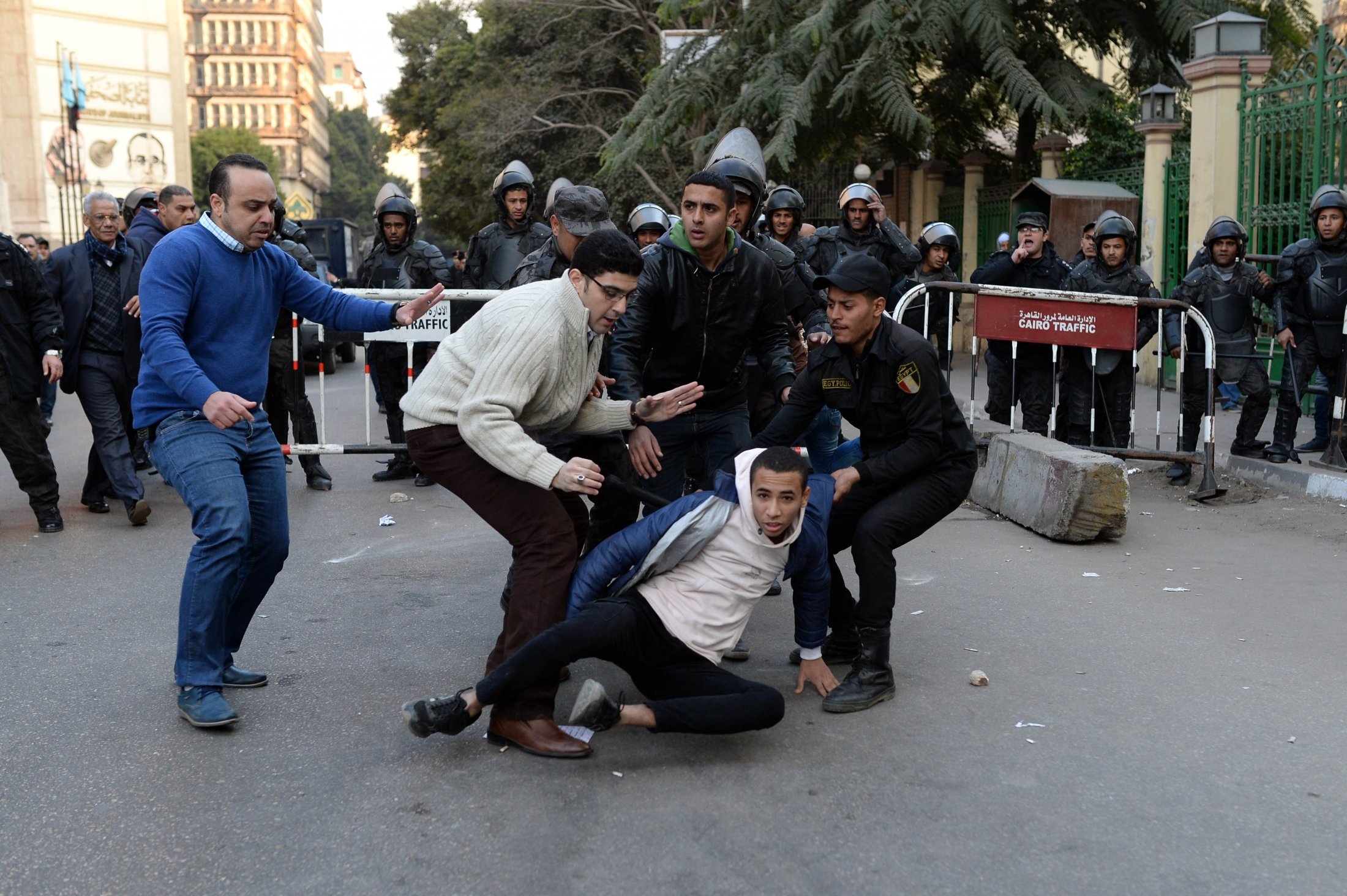 Police officers arresting a protestor after they attacked a peaceful rally against Tiran and Sanafir Island deal, Jan. 2. 2017. Cairo, Egypt.