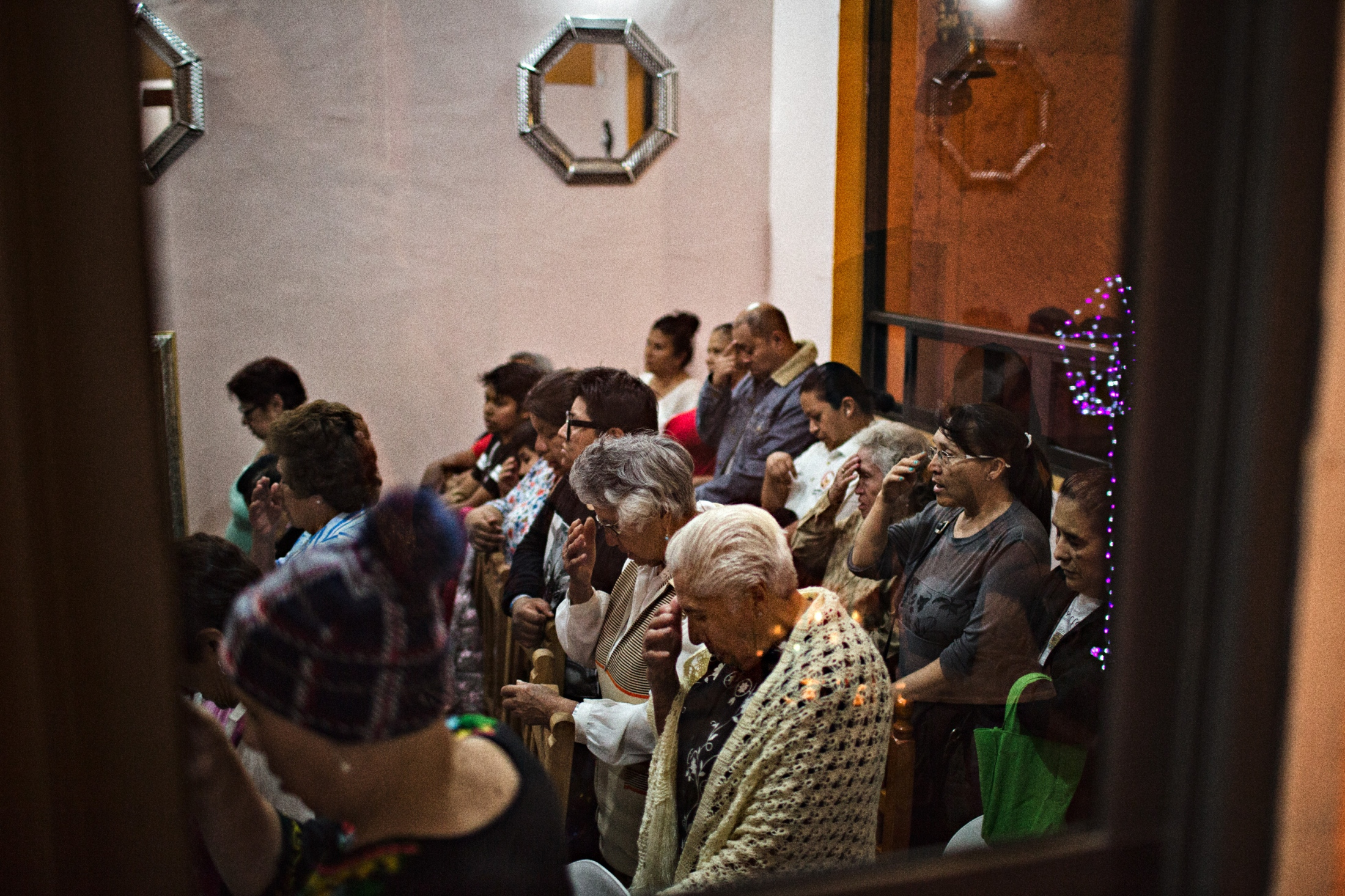 When Jorge Serralte Huerte remodled his home fourteen years ago, he anticipated the need to a place for worshipers to come and pray during the year Niñopa is guest in his home. The area can hold some 40 people and each night, at 8:00pm it is time for Rosaries. On an average day, about 100 to 150 worshipers visit the house.