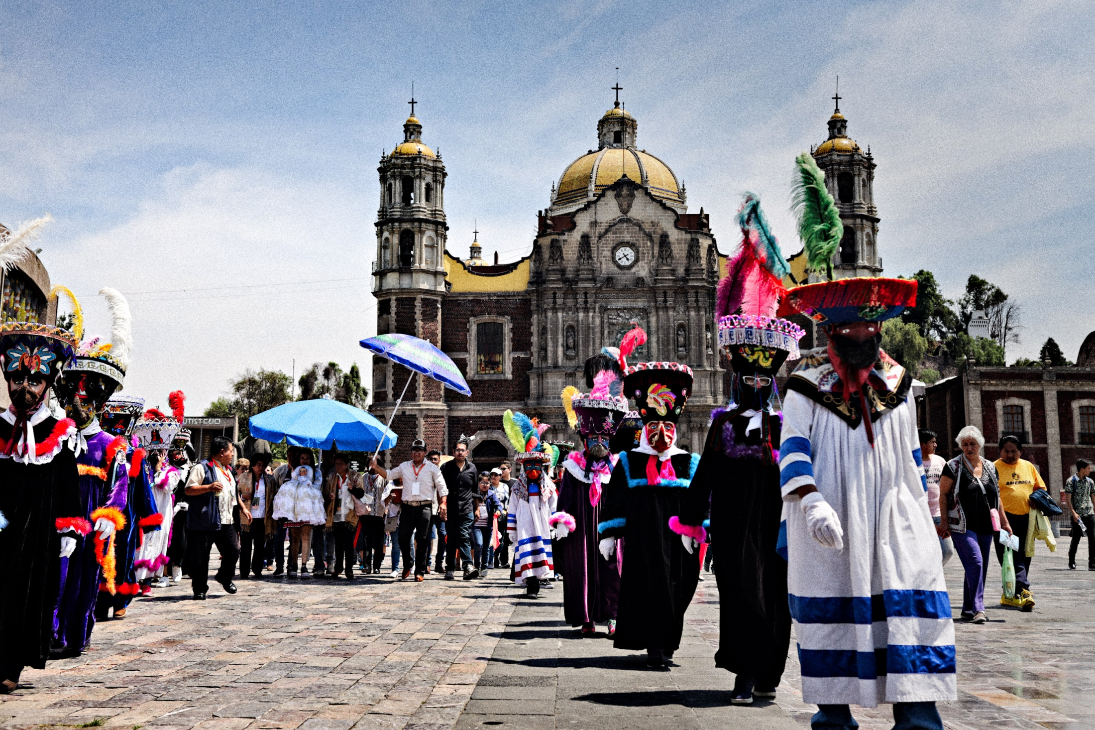 After attending mass at the Basilica of Our Lady of Guadalupe, Niñopa leaves the ground preceded by dancers and musicians.