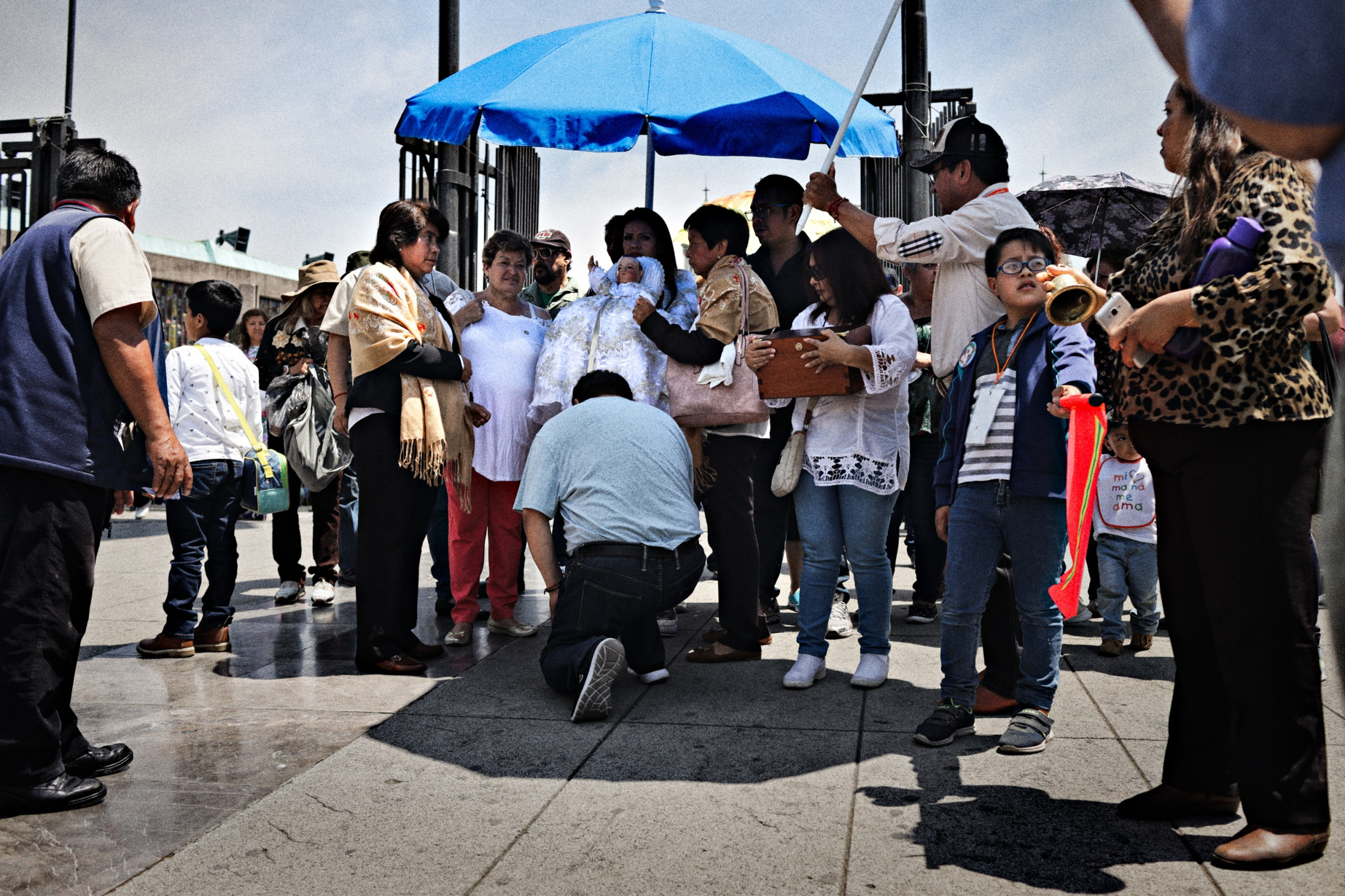 After attending mass at the Basilica of Our Lady of Guadalupe, Niñopa is met by worshipers who pay their respect.