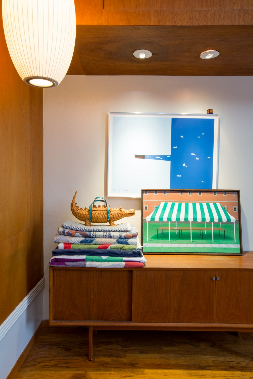 A collection of quilts and alligator purse in the couple's bedroom