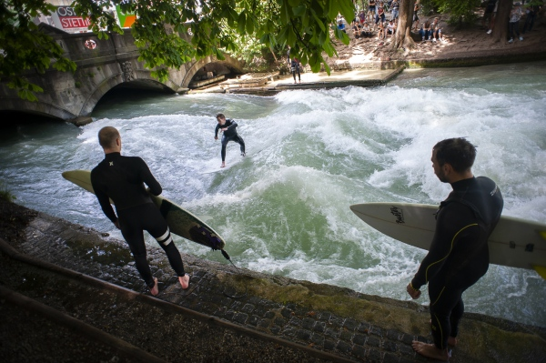 The standing wave of the Eisbach, Munich Bavaria, Germany. Its water is cold and shallow, but it's a constant for the citys surf community.
