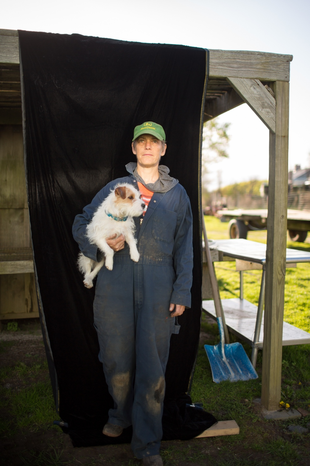 Marilee Foster of Foster Farm in Sagaponack, poses with her dog, Bird