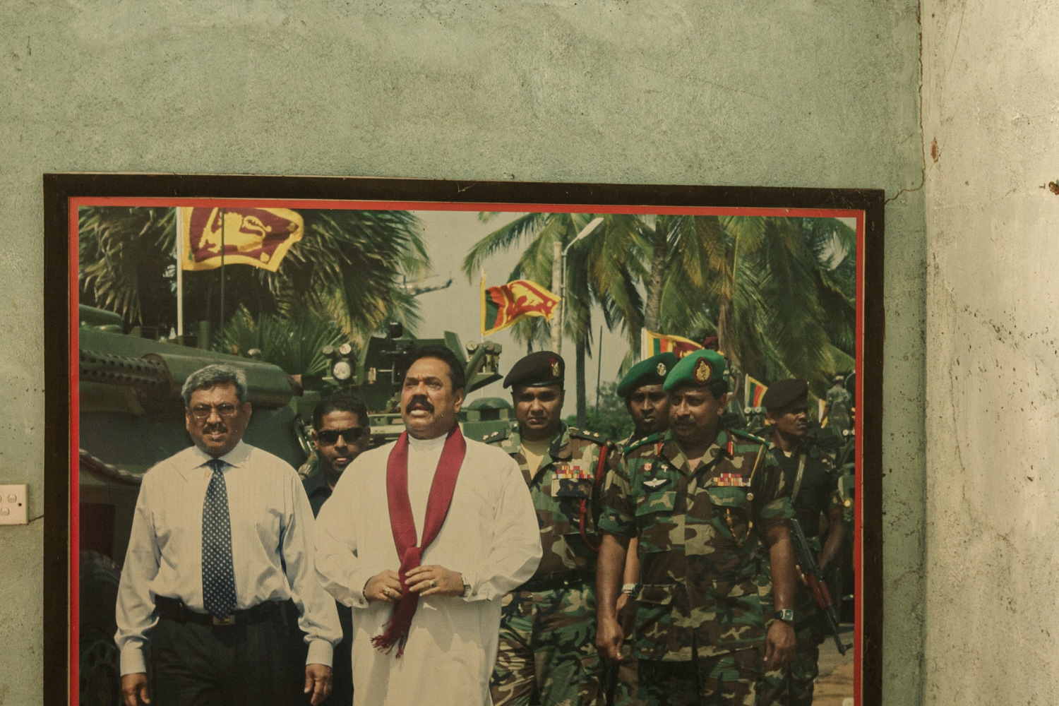 A picture of a military celebration with the ex-President, Mahinda Rajapaksa (centre), and his brother, Gotabhaya Rajapksa (right), ex-Minister of Defence. Together they oversaw and executed the final phase of the civil war in 2009, in which tens of thousands of Tamil civilians were killed in a matter of months. Gotabhaya Rajapksa used the aftermath of the Easter Sunday attacks to announce his run for the presidency and the need for strong leaders who would put Sinhalese Buddhists first. (September, 2015)