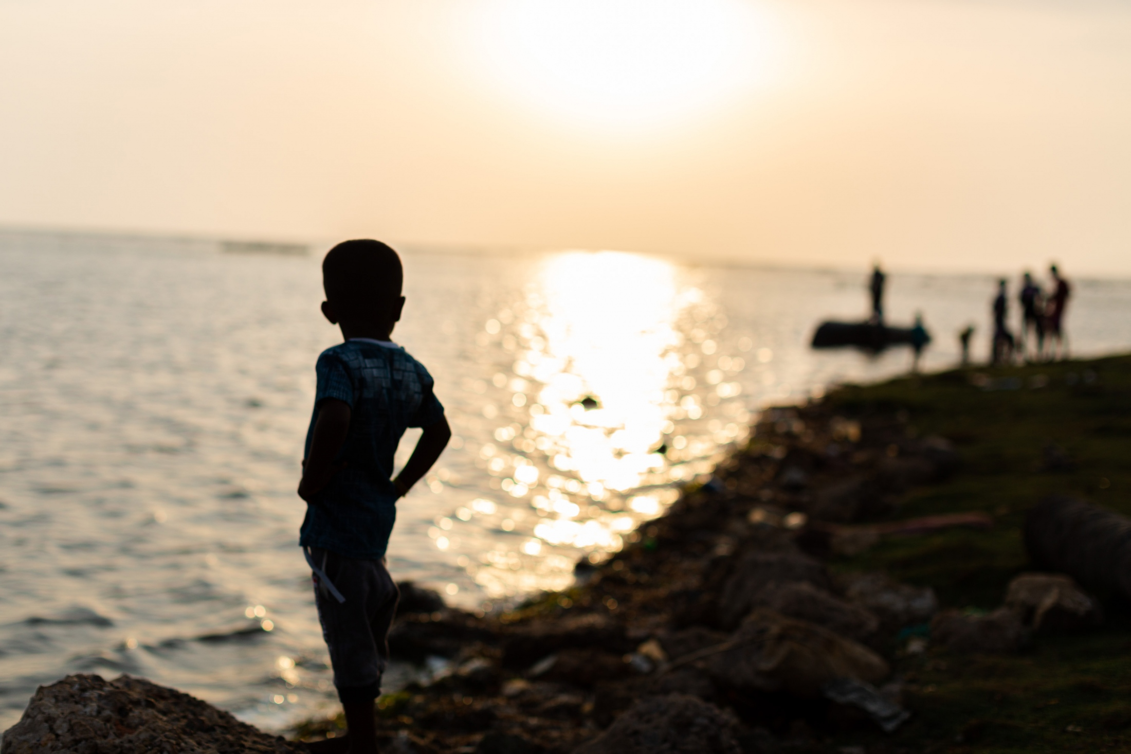 A young boy watches fishermen coming into the shore in Jaffna. (May, 2019)