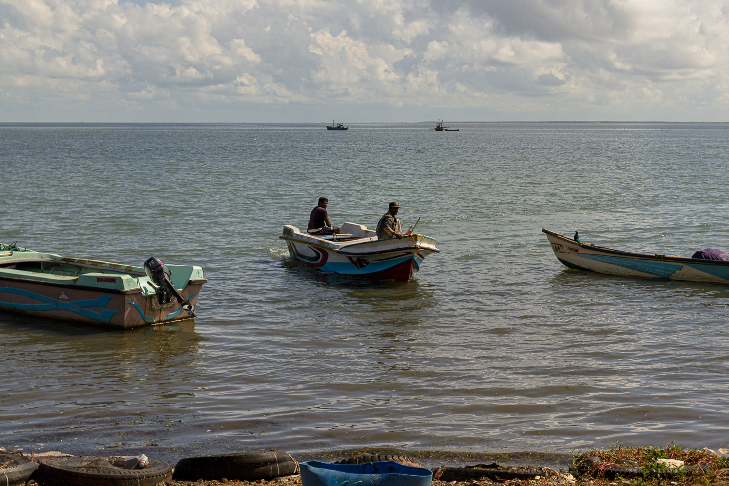 Two navy soldiers arrive to shore in Mannar, the northern most point of Sri Lanka. At a time when the Sri Lankan Government were in Geneva promising the de-militarisation of the north. (September, 2015)
