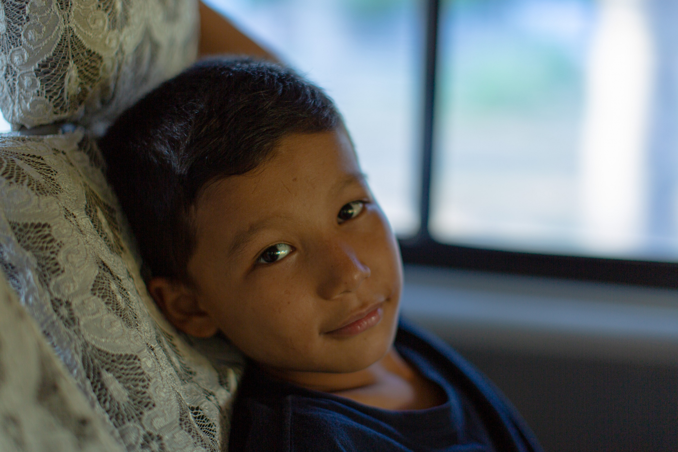 Ali Ahmadi, 11, on the last leg of a journey to a safe house in Jaffna, that saw his family stopped 18 times at army checkpoints and... (May, 2019)