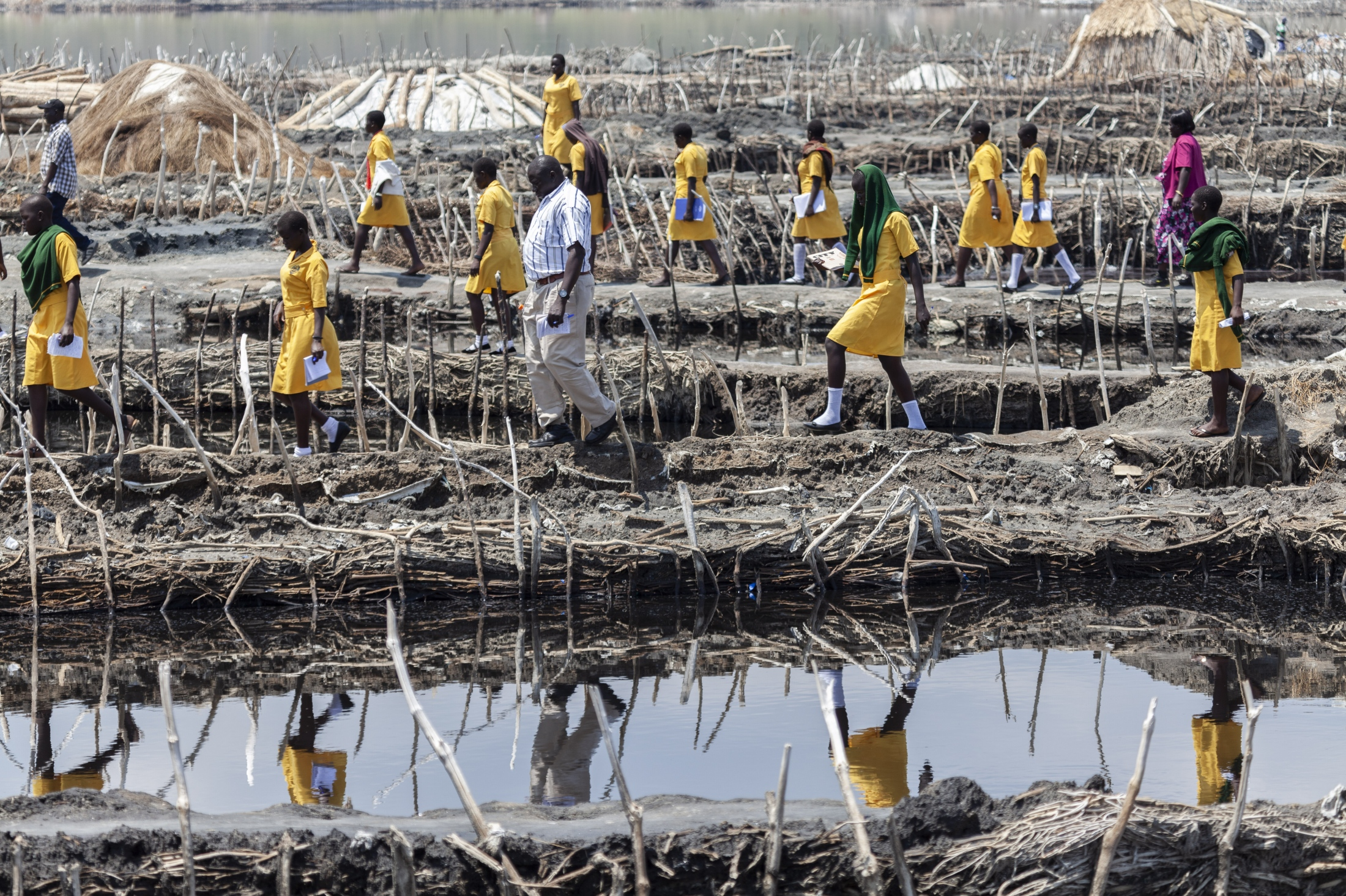 Photography image - Students visiting the salt mines at Lake Katwe in Uganda.