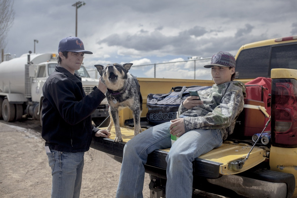 Two brothers in the parking lot outside of a rodeo. Alamosa, Colorado.
