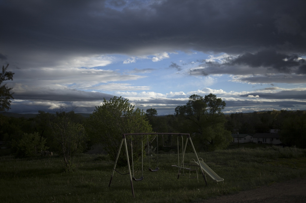 Temperamental weather moves across a playground. Craig, Colorado.