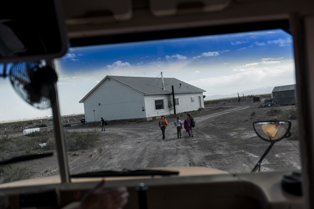 The bus drops students off at a home which also fosters other children. Saguache, Colorado.