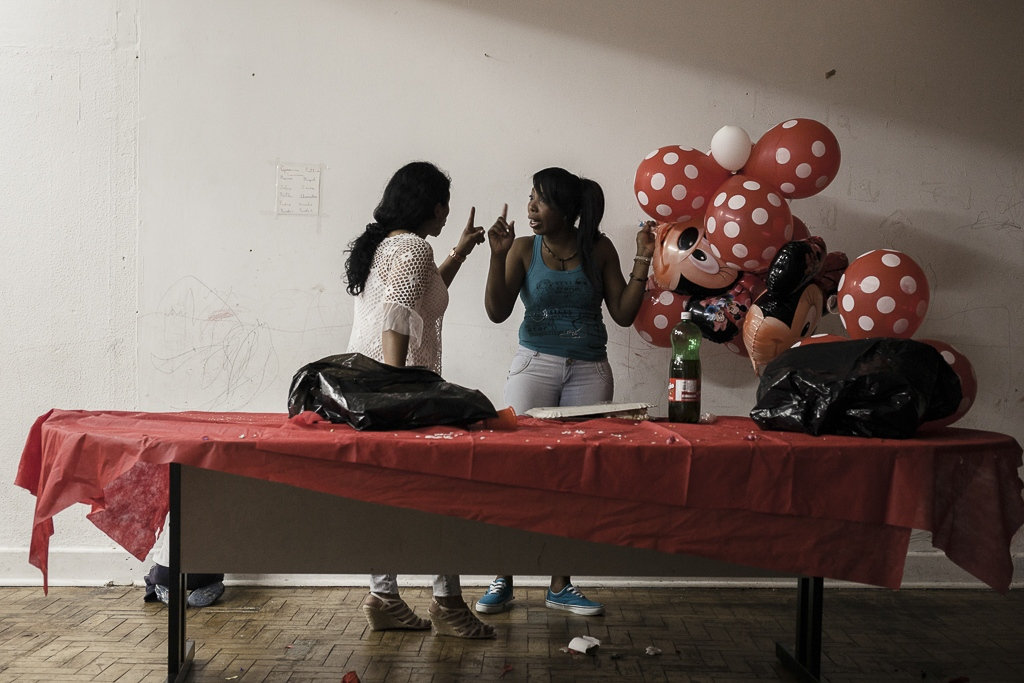 """A birthday party for one of the children that live inside the squat. These special events are celebrated by the entire community trying to bring some kind of """"normal"""" activities for the kids."""