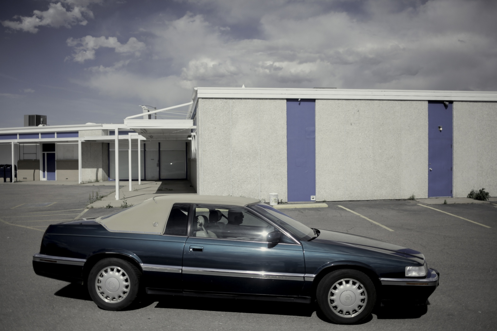 A parking lot in an abandoned strip mall.