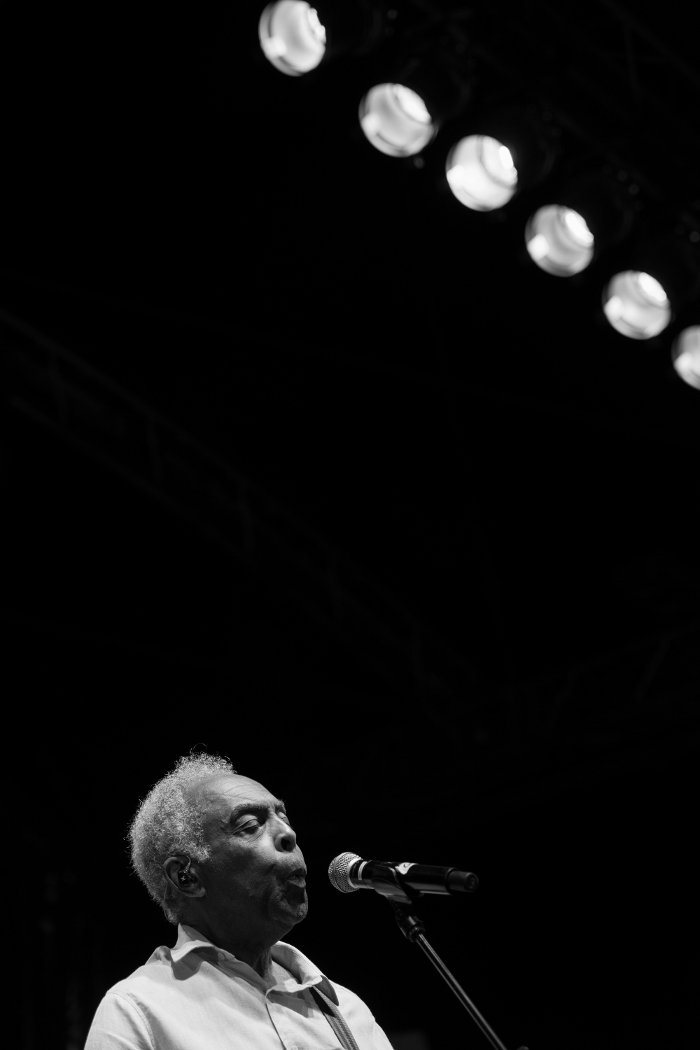 World-famous Brazilian musician Gilberto Gil whistles during a song at his concert. Wassermusik Festival, Berlin, July 14, 2019.