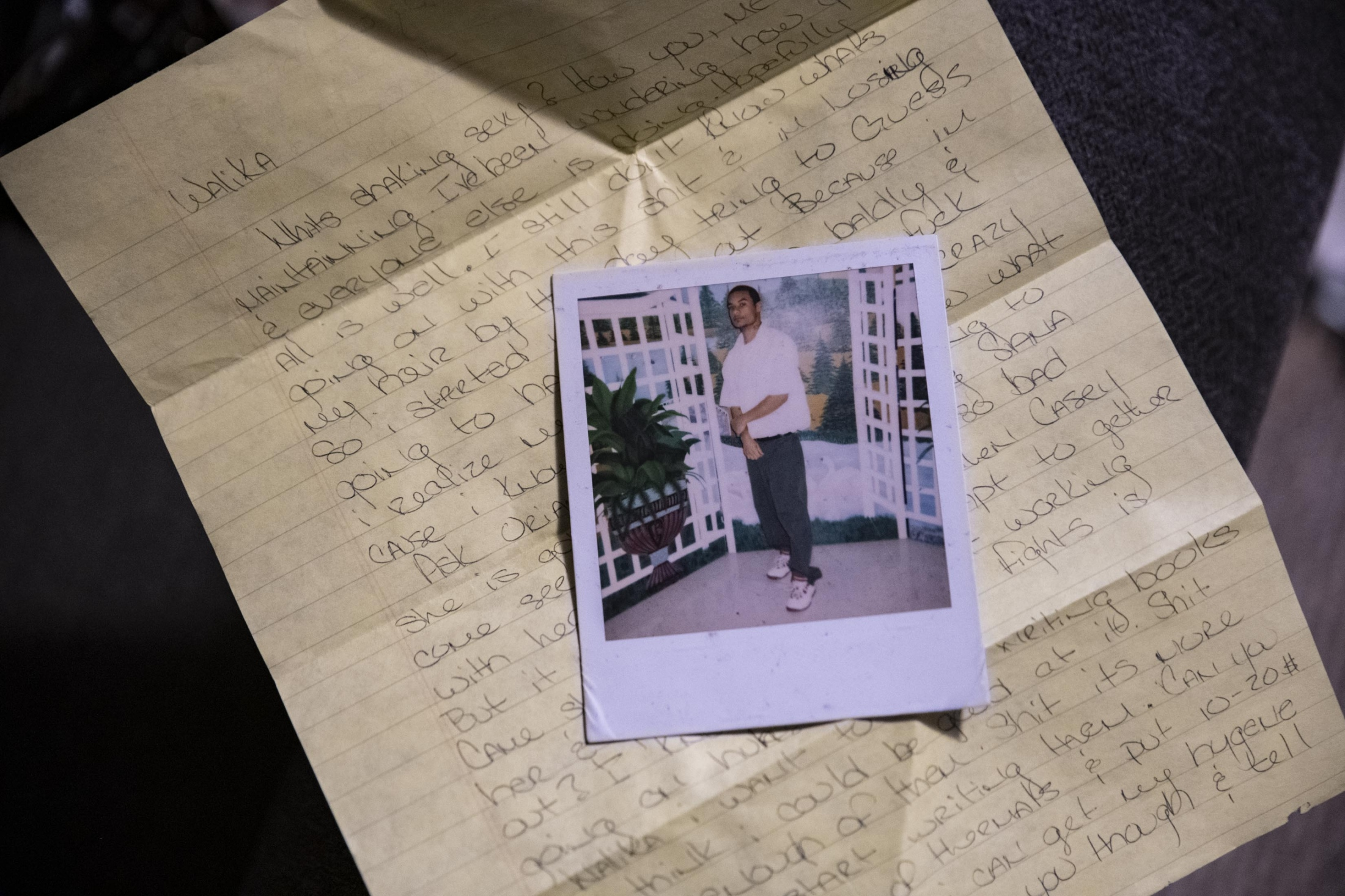 A letter and Polaroid Morrice sent to Walika from prison.