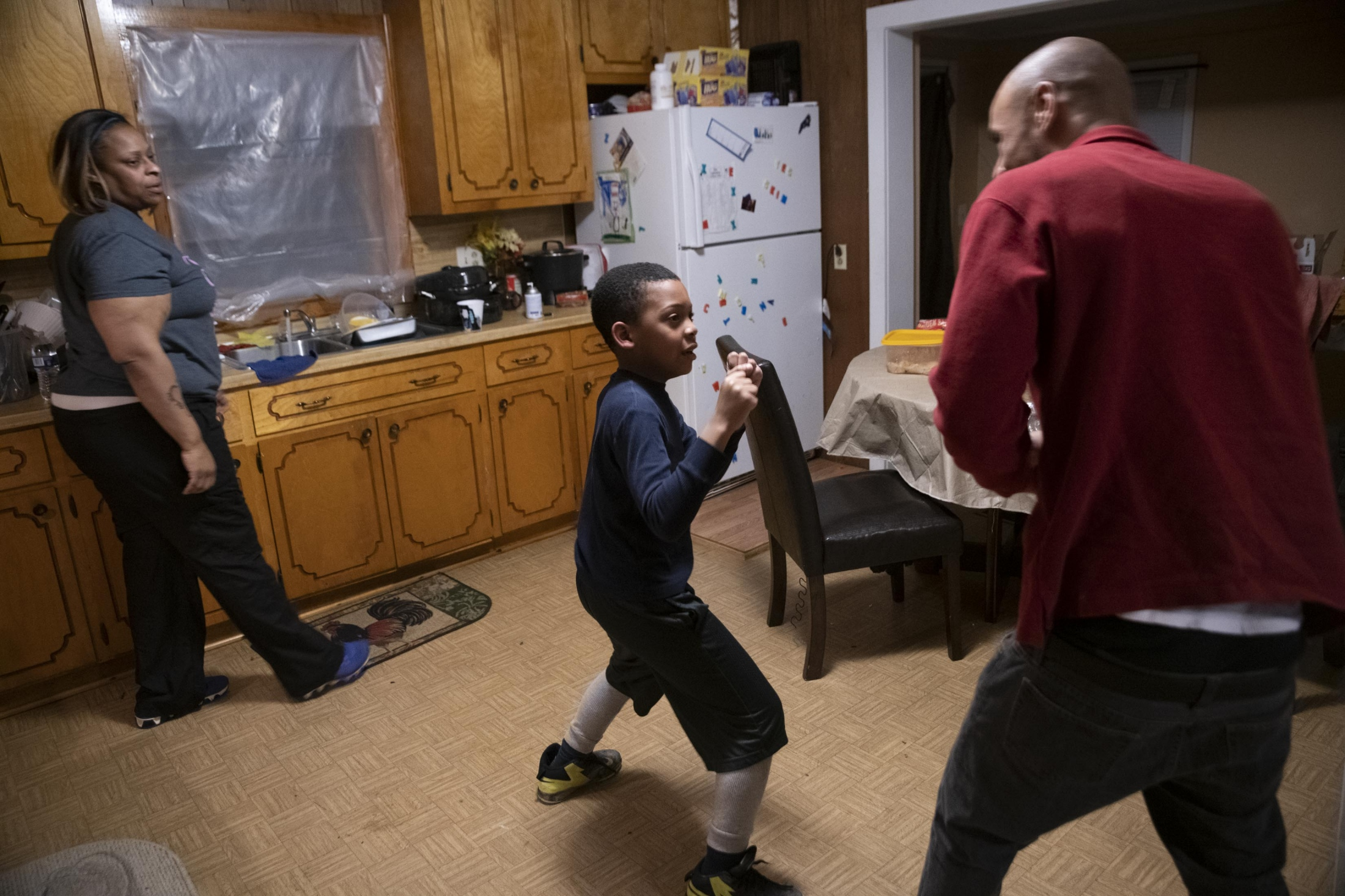 Ma'Khi and Morrice play fight, toughening him up for karate and football.
