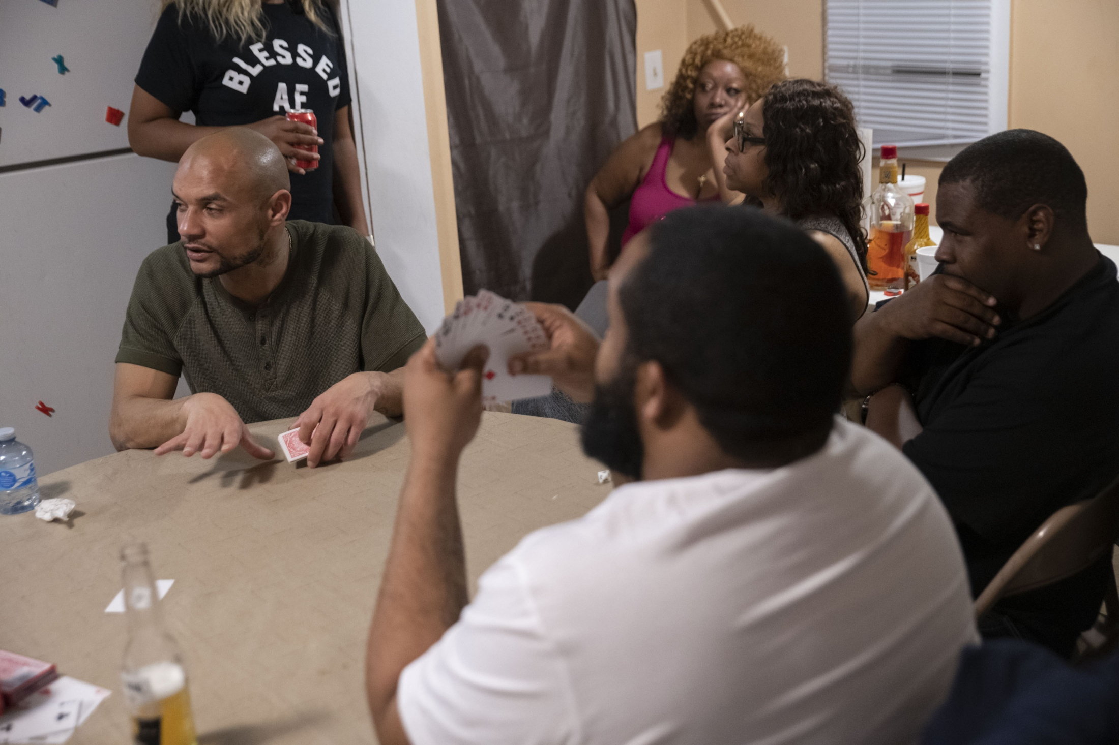 Morrice and family play spades during the reunion.
