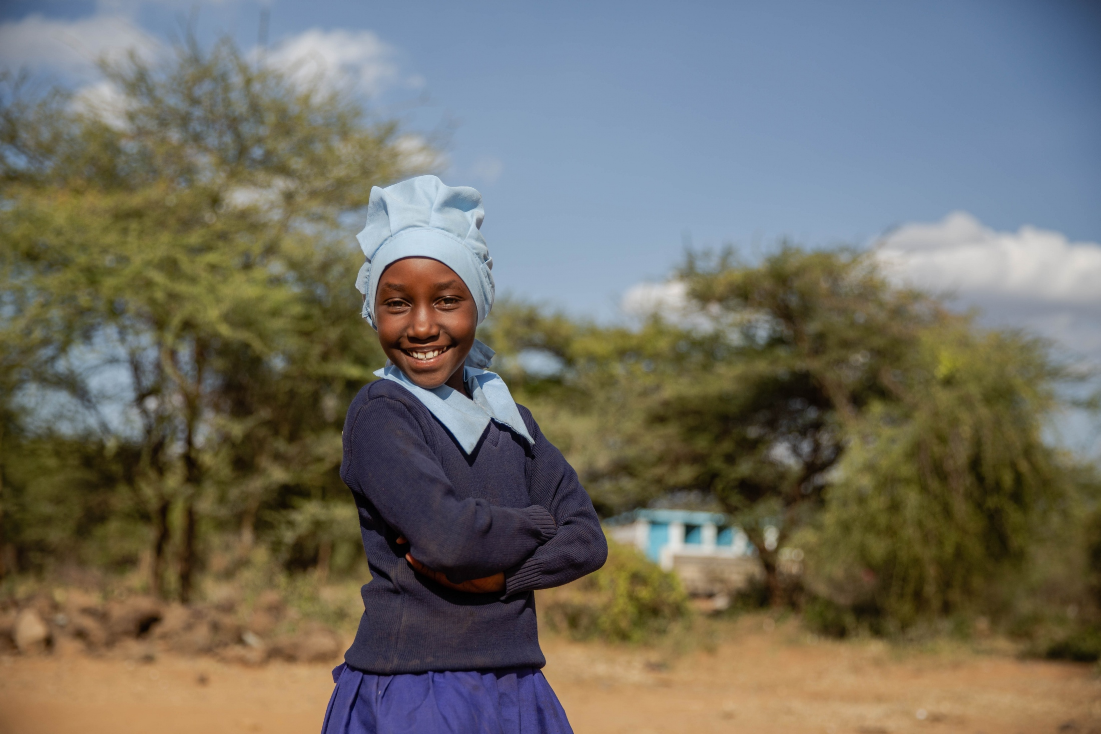 A pupil at Elangatawaus primary school in Kenya poses for a portrait. For World Relief.