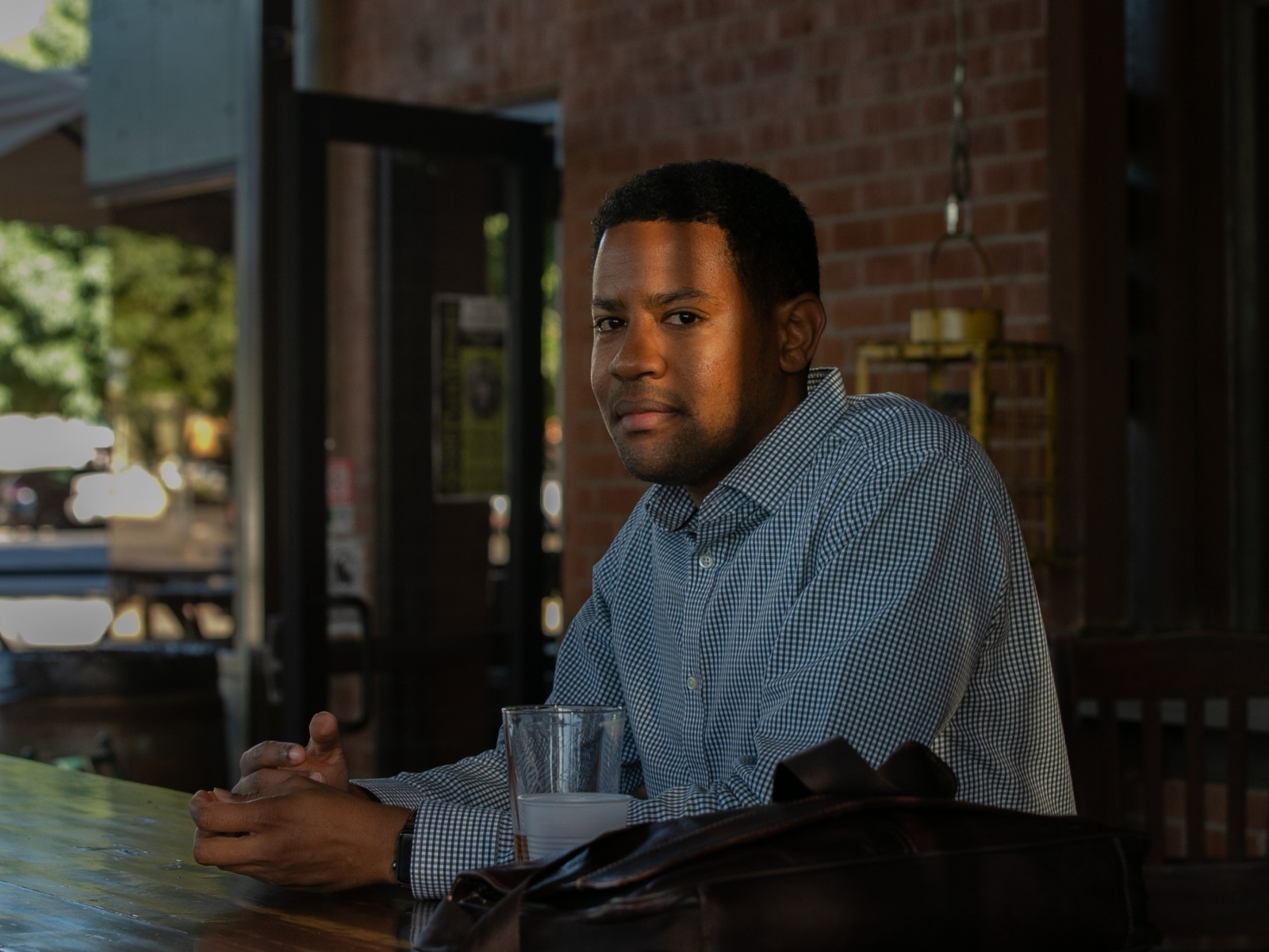 Downtown Phoenix resident Omar Peters enjoys a beer after work at The Grand Cafe in Phoenix, Ariz.