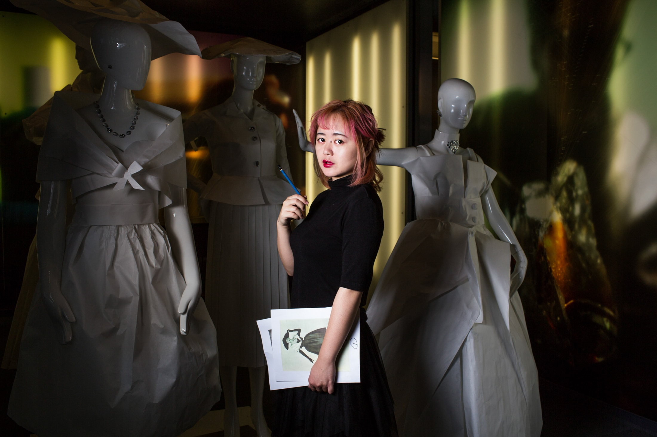 Guo Jia, an industrial design student at Syracuse University, stands for a portrait.