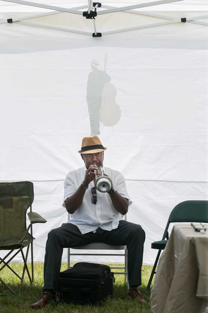 Brian Freeman practices the trumpet before his performance at the 23rd Masten Jazz Festival at the grounds of the Buffalo Museum of Science.