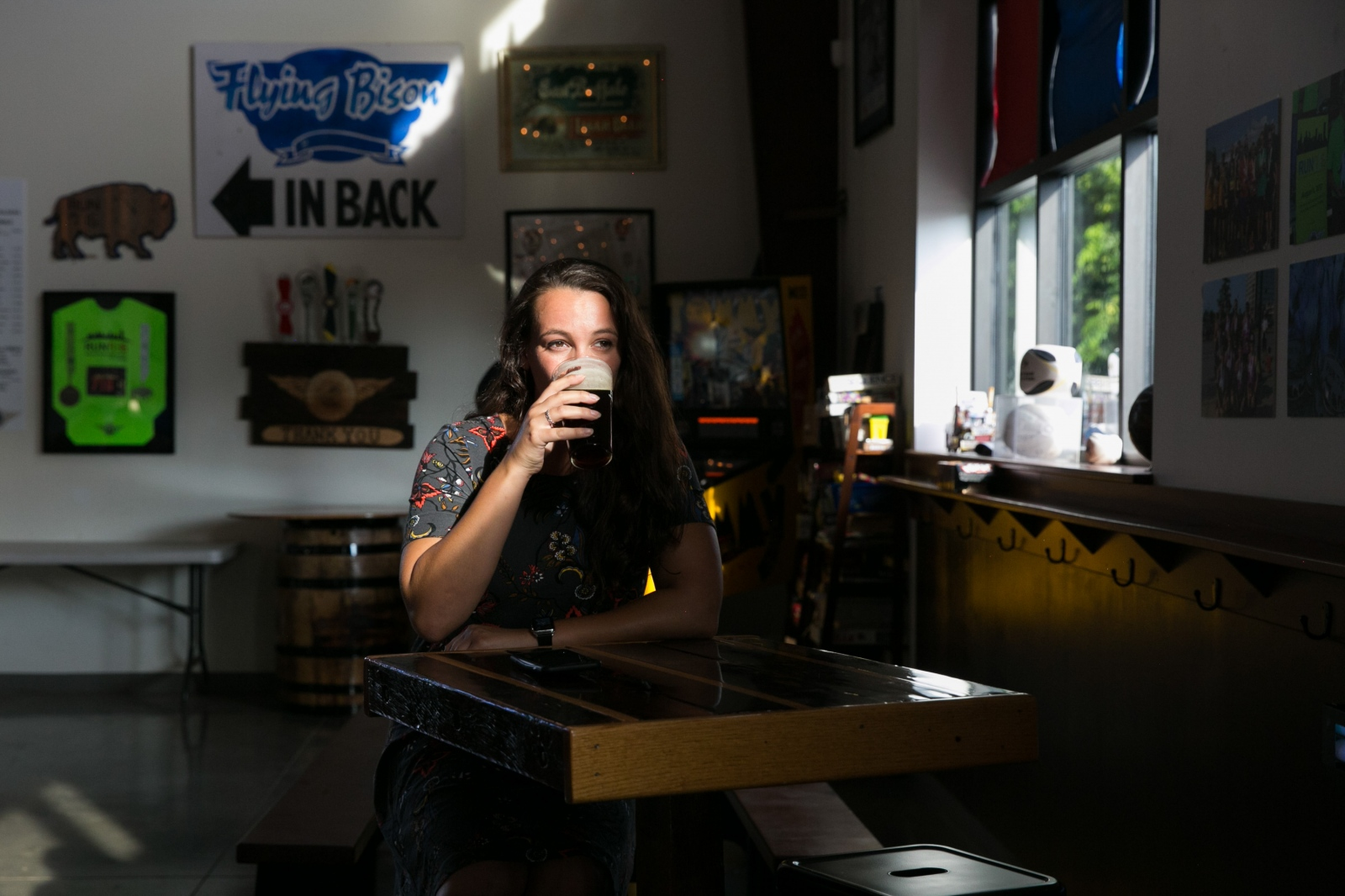 Tim Herzog's niece Jessica Yogel relaxes and drinks beer in Flying Bison in Buffalo, N.Y.