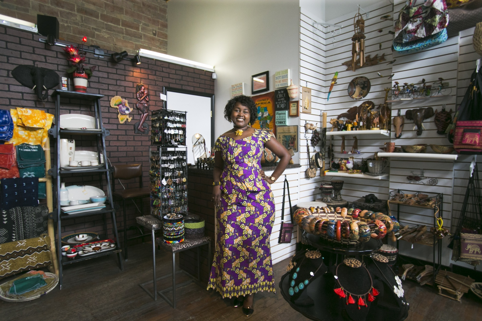 Louise Sano, owner of Global Villages and Global Chic on Grant Street, wears a favorite dress made from African wax print fabric.