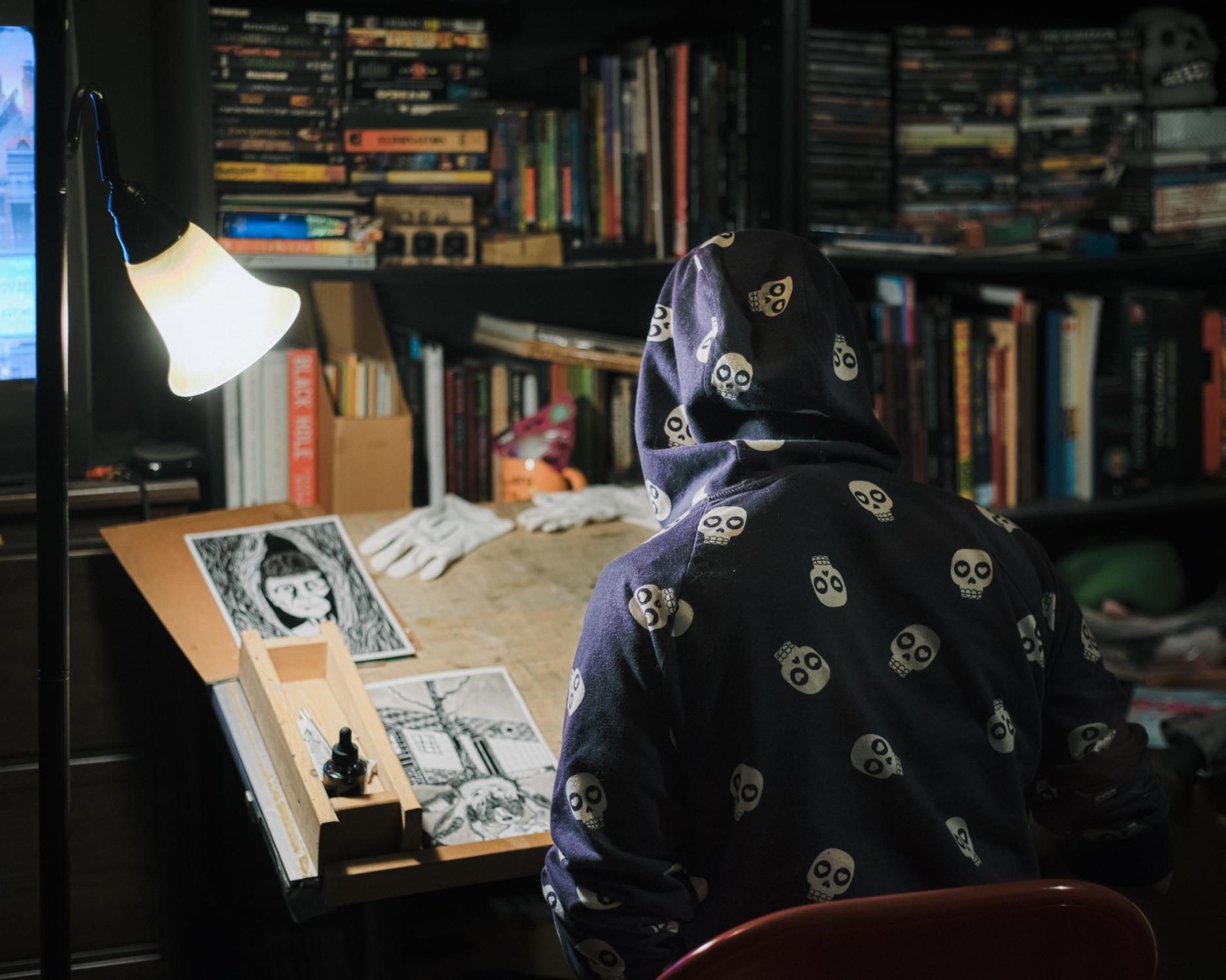 Jamesy drawing at his desk, 2019