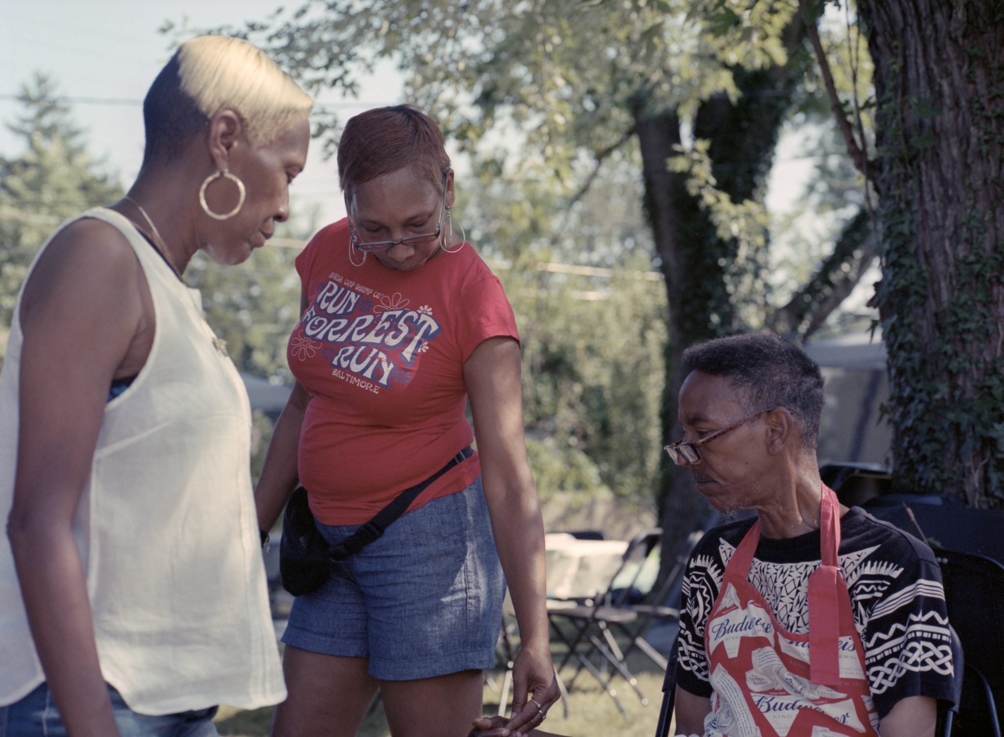 My Mother giving Uncle Rod ice at the Family Cookout. He felt lightheaded. Aunt Cheryl trying to make him feel better. 2018
