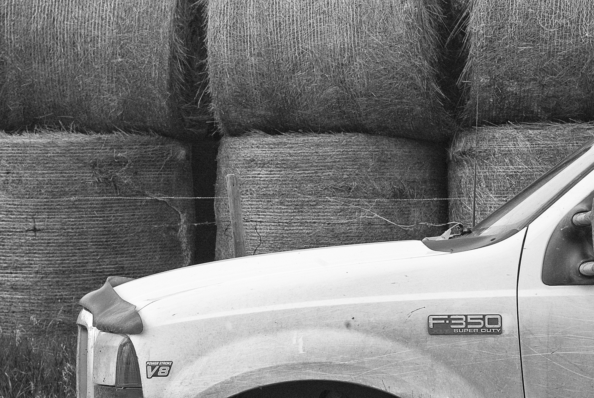 Art and Documentary Photography - Loading Work_Truck_With_Bails__Saskatoon.jpg