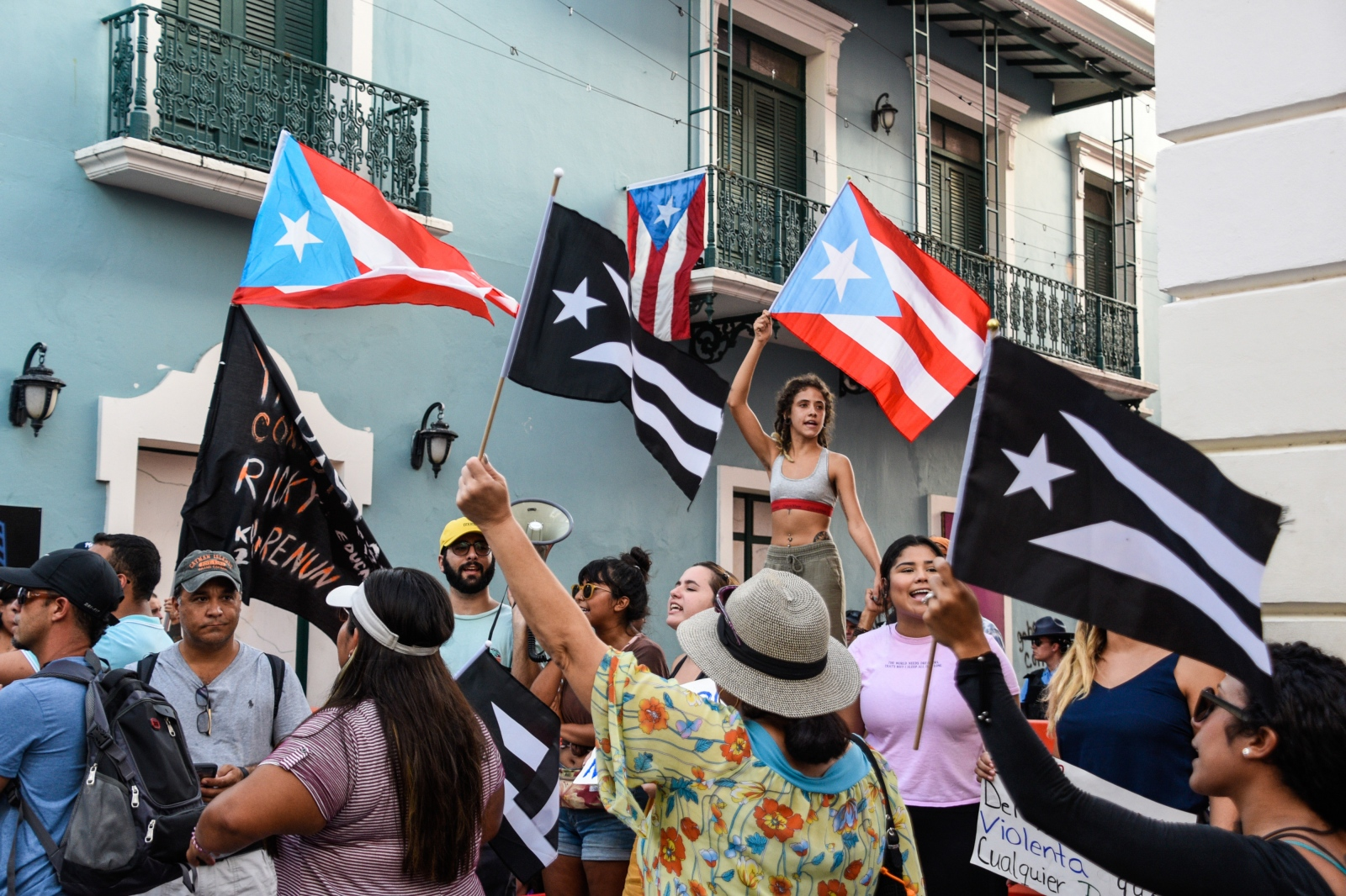Demonstrators wave Puerto Rican flags during the protests calling for the resignation of Governor of Puerto Rico, Ricardo Rosselló. Shot while on assignment for Reuters on July 16, 2019.