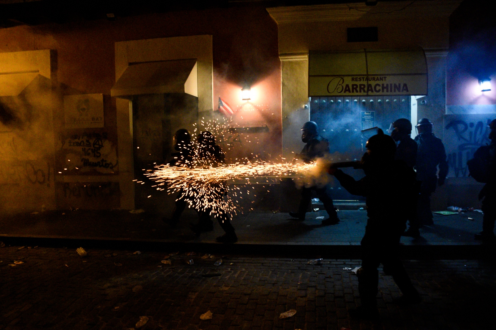Police fire tear gas at demonstrators during the protests calling for the resignation of Governor of Puerto Rico, Ricardo Rosselló. Shot while on assignment for Reuters on July 17, 2019.