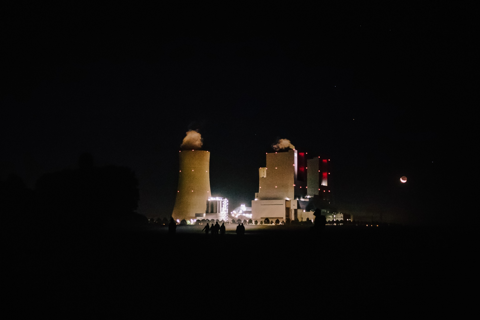 A group of activists approaches Neurath power plant for nightly action. 10-06-2018