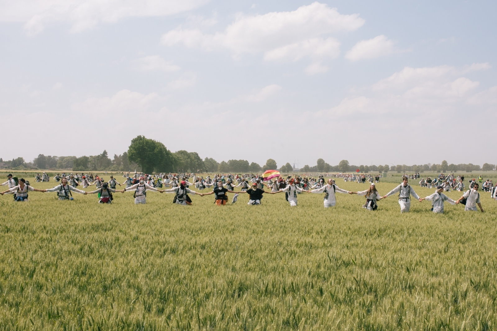 Activists move over fields to reach the open-surface coal-pit of Garzweiler. 06-22-2019