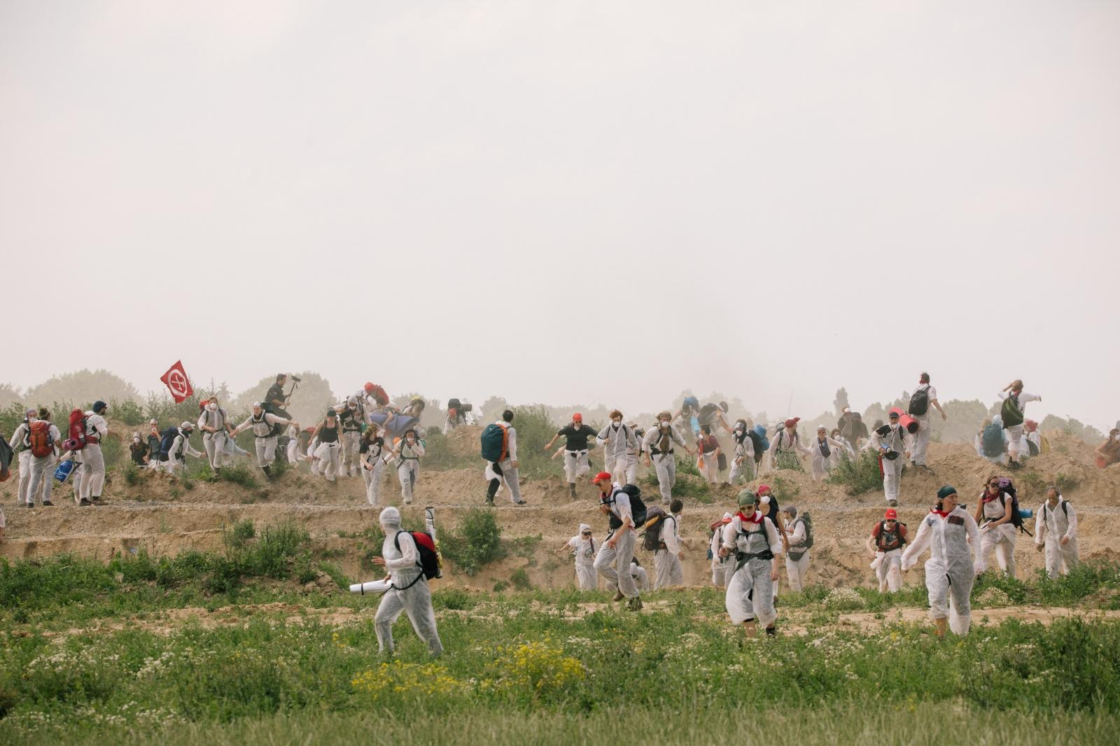 Activists storm a rampart near the open-cast coal-pit Garzweiler. 06-22-2019