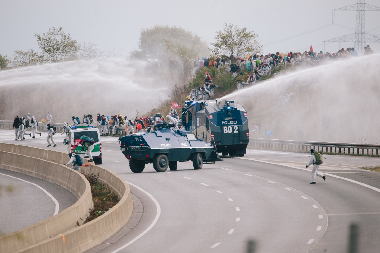 A huge of Ende Gelände group passes a highway. 10-27-2018