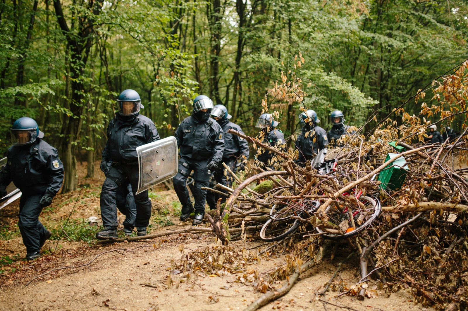 Policemen pass a block during the eviction of Hambach Forest Camp. 09-13-2018