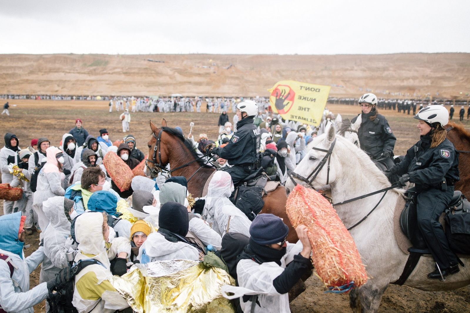Police on horses pushes into group of activists in the mine of Hambach. 11-05-2017