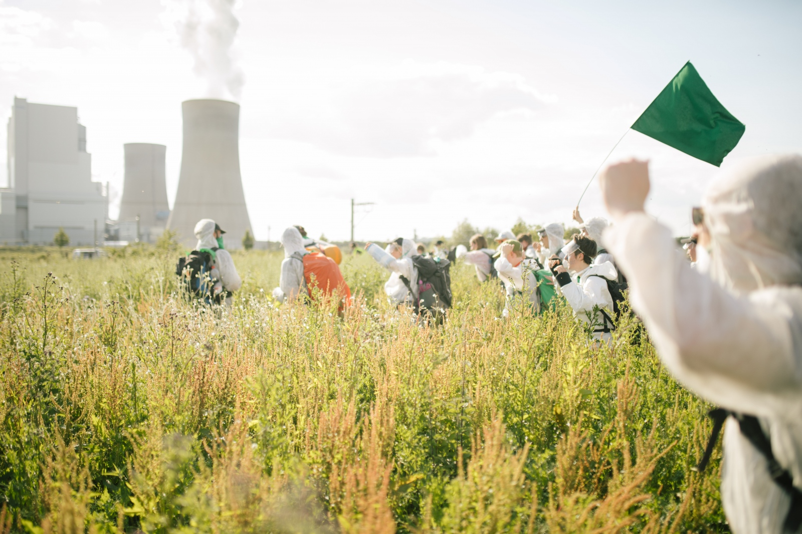 Activists on a field towards train tracks near Neurath power plant. 06-21-2019